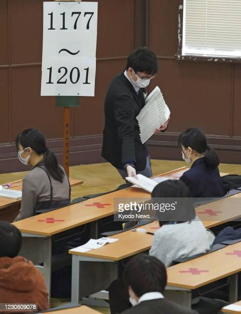 Students take entrance exams at the University of Tokyo on Jan. 16, 2021. Japan's new unified university entrance exams started the same day across...