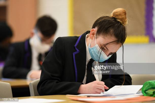 Students take part in a class at Park Lane Academy in Halifax, northwest England on March 17, 2021.