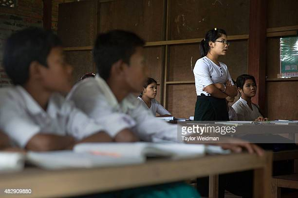 Students take part in a classroom exercise in a school inside the planned Dawei SEZ on August 3 2015 in Mudu Myanmar The controversial multibillion...