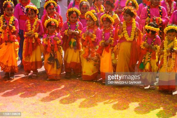 Students take part in a cultural procession to celebrate Holi the spring festival of colours in Kolkata on March 9 2020 Holi is observed in India at...
