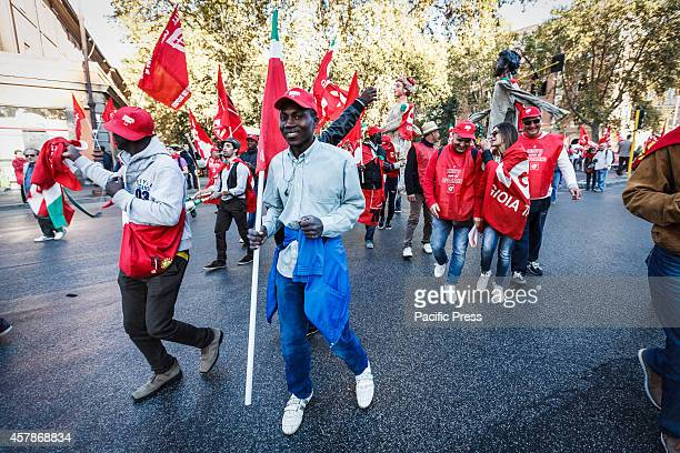 Students take part in a demonstration organised by the Italian trade union CGIL to protest in Rome against the Italian government's plans to overhaul...