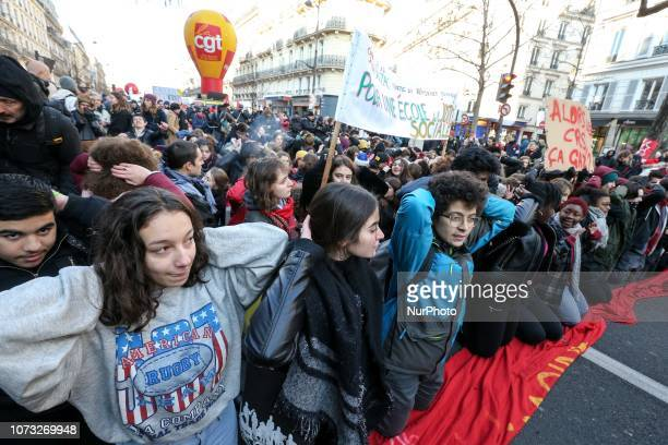 Students take part in a demonstration to the call the CGT Union on December 14 2018 in Paris to call for politcal measures against high living costs...