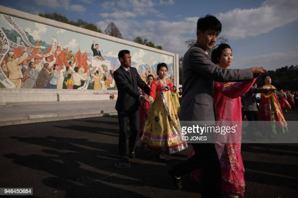 Students take part in a mass dance event during celebrations marking the anniversary of the birth of late North Korean leader Kim Il Sung in...