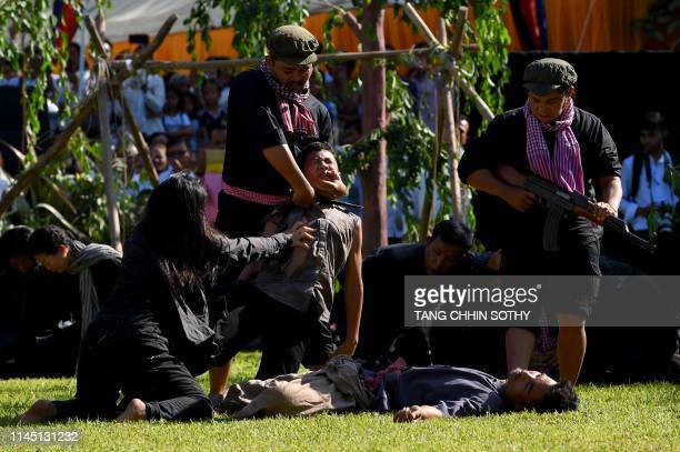 Students take part in a performance to mark the annual 'Day of Remembrance' at the Choeung Ek killing fields memorial in Phnom Penh on May 20 2019...