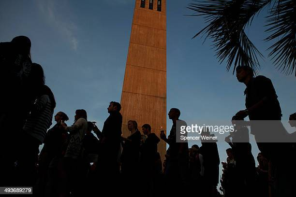 Students take part in a procession in silence as they march towards the scene of the violence after a gathering on the UC Santa Barbara campus for...