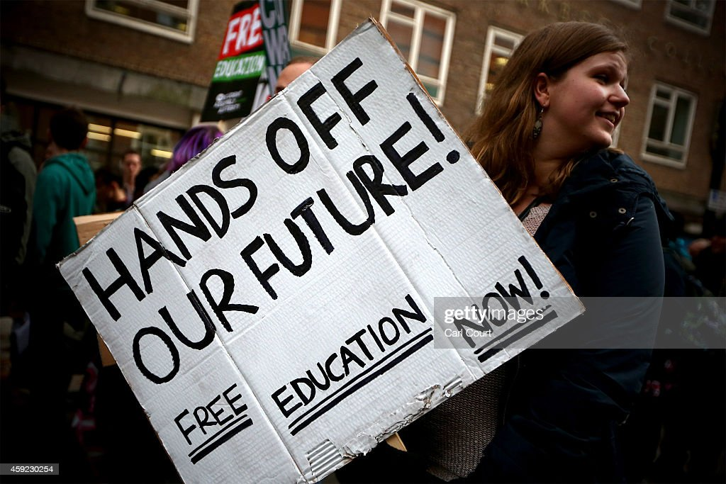 Students take part in a protest against fees and cuts in the education system on November 19, 2014 in London, England. A coalition of student groups have organised a day of nationwide protests in support of free education and to campaign against cuts.