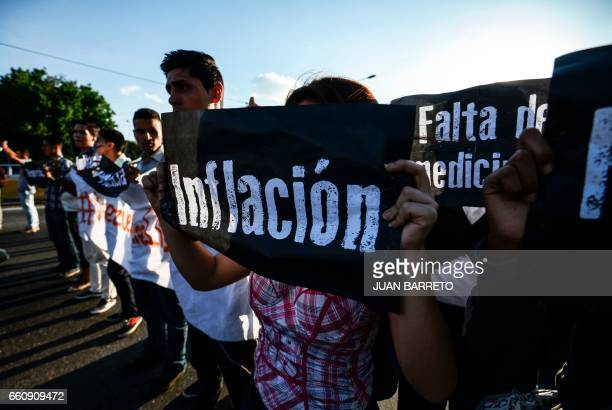 TOPSHOT Students take part in a protest against Venezuelan President Nicola Maduro on the main highway in Caracas on March 30 2017 Venezuela's...