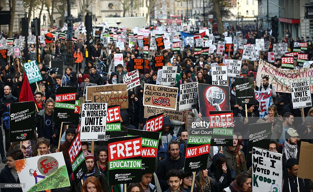 Students take part in a protest march against fees and cuts in the education system on November 19, 2014 in London, England. A coalition of student groups have organised a day of nationwide protests in support of free education and to campaign against cuts. Photo by Carl Court/Getty Images)