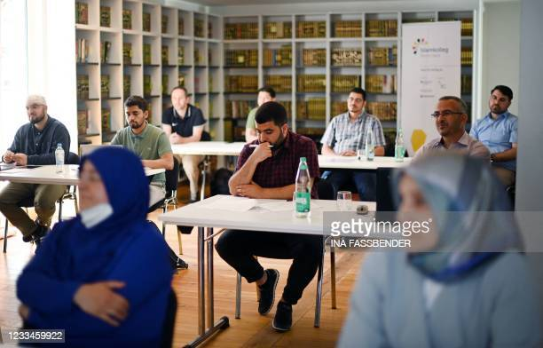 Students take part in a Qur'an recitation lesson at the Islamkolleg Deutschland in Osnabrueck, western Germany on June 14, 2021. - The first block...