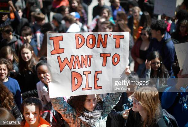 Students take part in a rally for National School Walkout Day to protest school violence on April 20 2018 in Chicago Illinois Students from around...