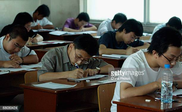 Students take part in the college entrance exam at an exam room in a middle school on June 7 2005 in Xian of Shaanxi Province China About 867 million...