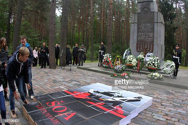 Students take part in the 'LithuanianJewish genocide commemoration ceremony' honouring the victims of the Holocaust in Paneriai near Vilnius on...