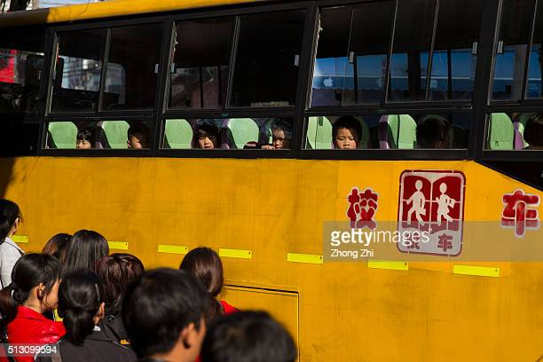 Students take school bus at Kanglecun one of the urban villages in Guangzhou on February 29 2016 in Guangzhou Guangdong Province China China's...