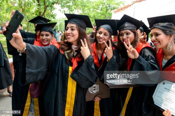 Students take selfie after receiving their Doctor of Philosophy degree during the Golden Jubilee Year Convocation at the Guru Nanak Dev University in...