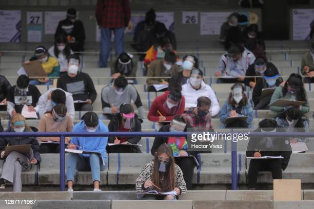 Students take the admission exam in the stands while following the preventive measures to avoid Covid-19 at Olimpico Universitario Stadium on August...