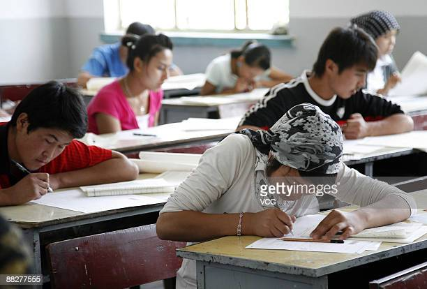 Students take the college entrance exam at a an exam site on June 7 2009 in Hami of Xinjiang Uygur Autonomous Region China China's national college...