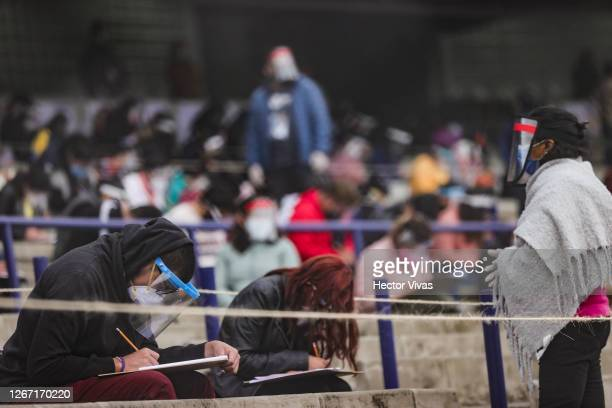 Students take the UNAM admission exam while following the preventive measuress to avoid the spread of Covid-19 at Olimpico Universitario Stadium on...