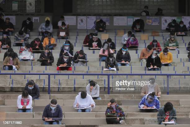 Students take their UNAM admission exam in the stands while following the preventive measuress to avoid Covid-19 at Olimpico Universitario Stadium on...