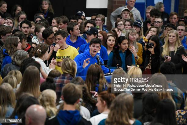STEM students take turns at the microphone giving speeches to honor Kendrick Castillo during a vigil in the gymnasium at Highlands Ranch High School...