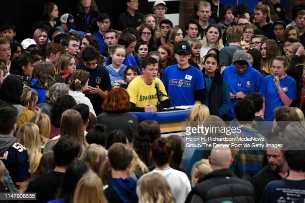 Students take turns at the microphone giving speeches to honor Kendrick Castillo during a vigil in the gymnasium at Highlands Ranch High School on...