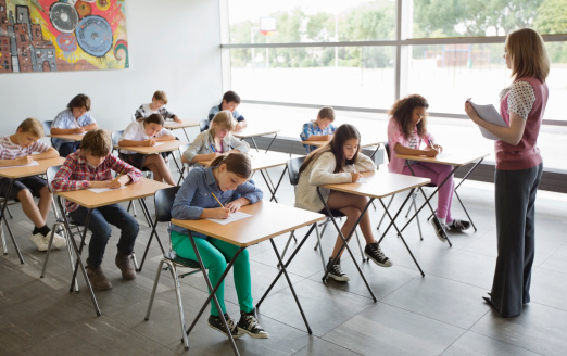 Students taking a test in classroom - gettyimageskorea