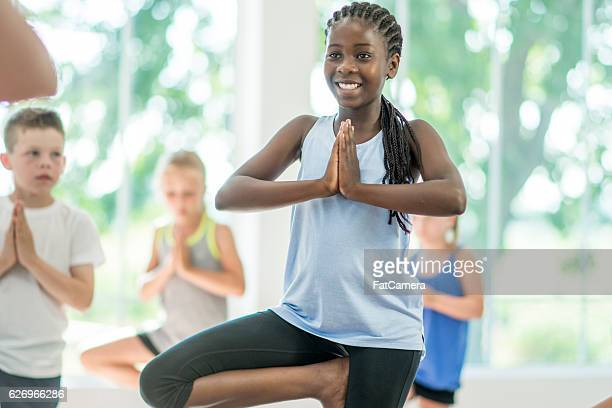 Students Taking a Yoga Class at the Gym