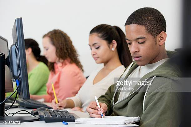 Students taking notes in class