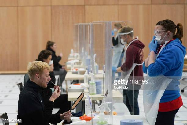 Students taking part in a mass lateral flow Covid-19 testing set up at the University of Hull's Sports Centre, as a part of the British government's...
