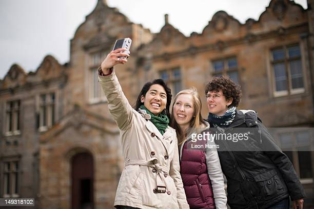 students taking pictures of themselves - st. andrews scotland stock pictures, royalty-free photos & images