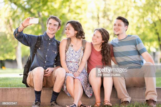 Students taking selfie on college campus