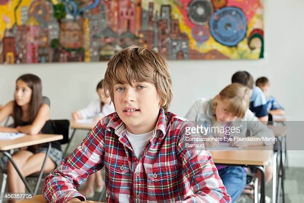 students taking test in classroom - schoolboy stock pictures, royalty-free photos & images