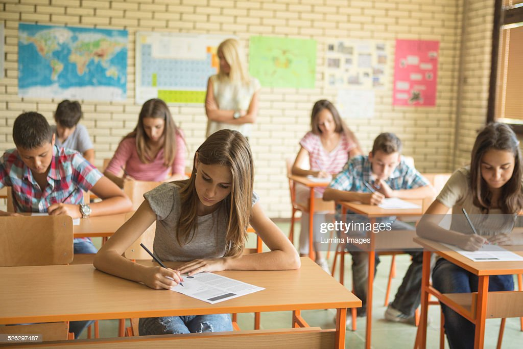 Students taking test in classroom : Stock Photo