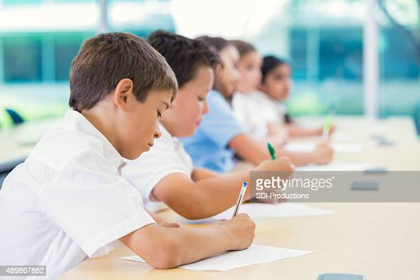 Students taking test in private elementary school