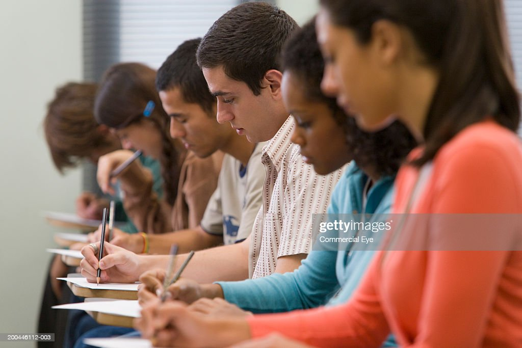 Students taking written examination, side view : Stock-Foto