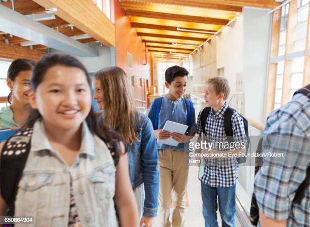 students talking in corridor - children only stock photos and pictures