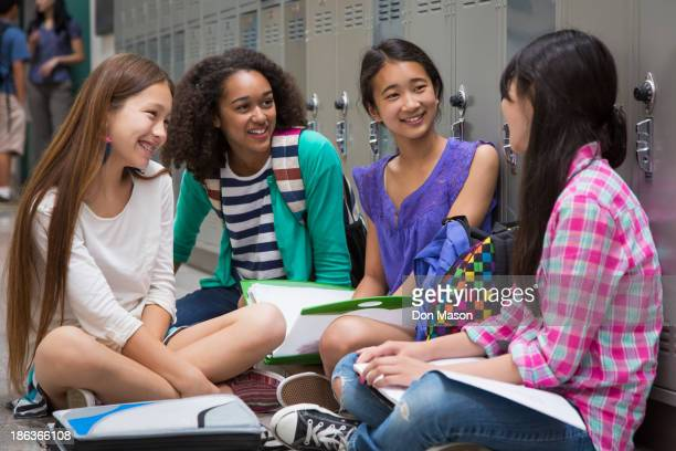 Students talking in school corridor