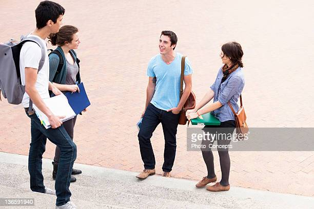 students talking on campus steps - peterborough ontario stock photos and pictures