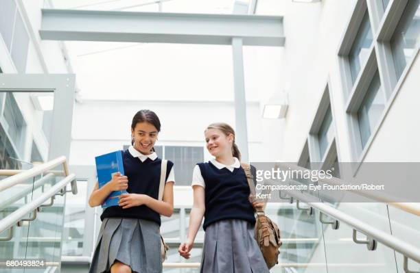 Students talking on stairs