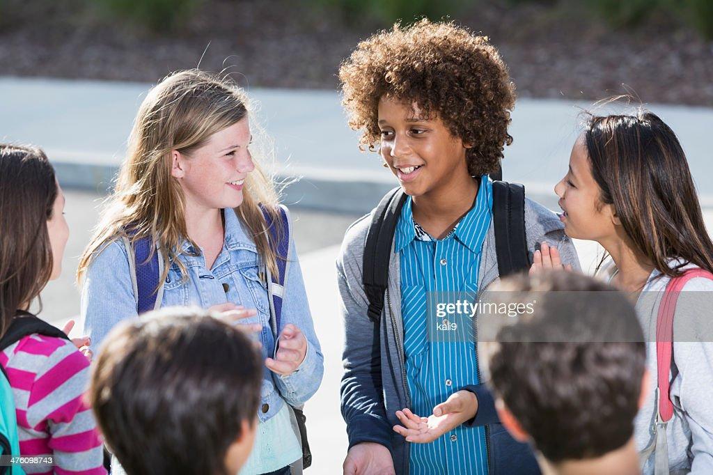 Students talking outdoors : Stock Photo