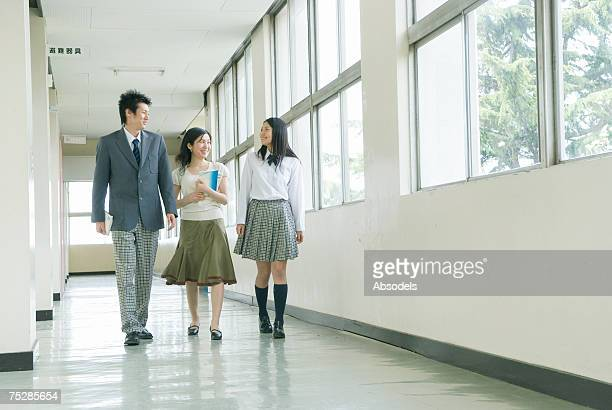 students talking to a teacher - japanese girls hot stock photos and pictures