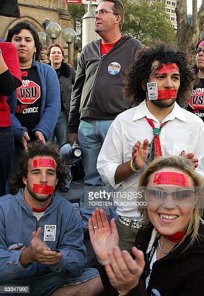 Students tape their mouths shut to show that they will not be silenced during a rally in Sydney against voluntary student unionism legislation, which...
