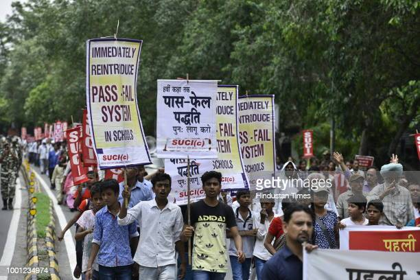 Students teachers and activists of SUCI participate in a rally from Mandi House to Sansad Marg to protest against the 'No Detention Policy' in the...