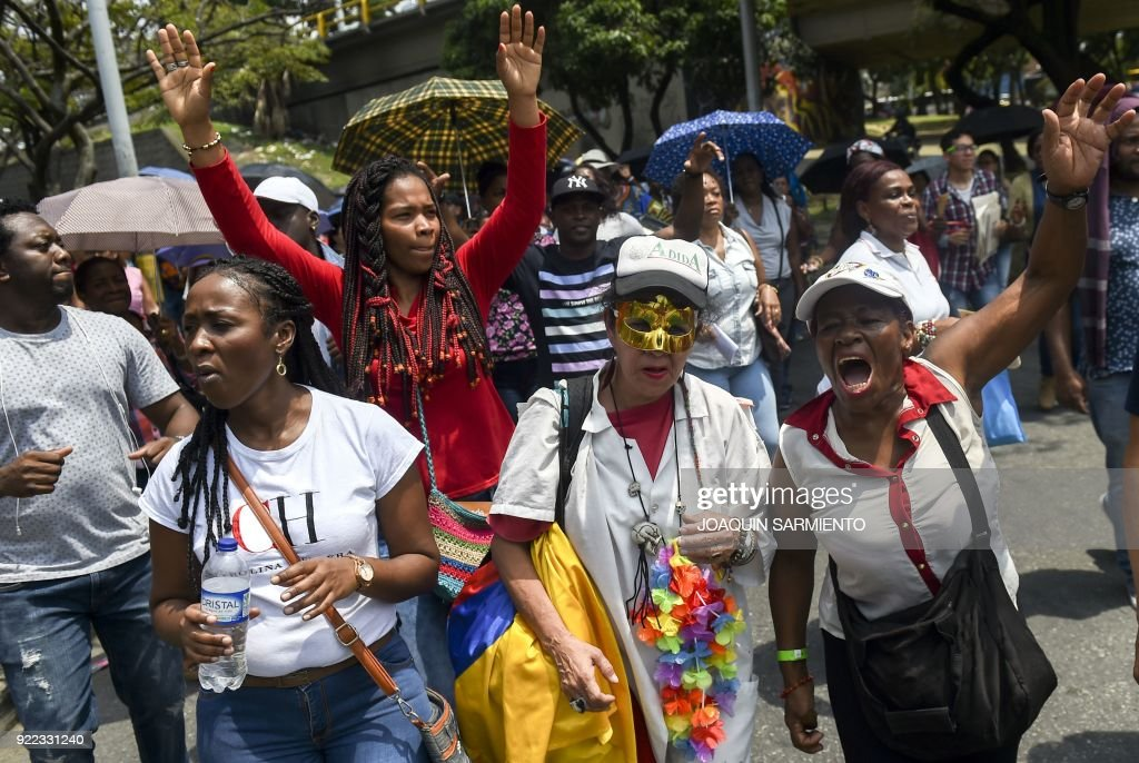 Students, teachers and social activists hold a demonstration demanding improvements in education, higher wages and better infrastructure in Medellin, Colombia, on February 21, 2018. /