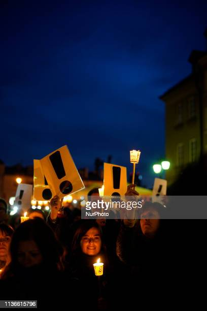 Students, teachers and supporters of the teacher's strike are seen at a candle light rally on Castle Square in the Old Town of Warsaw, Poland on...