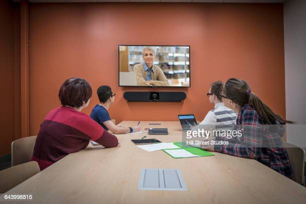 Students teleconferencing in study room