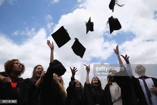 Students throw their caps in the air ahead of their graduation ceremony at the Royal Festival Hall on July 15 2014 in London England Students of the...