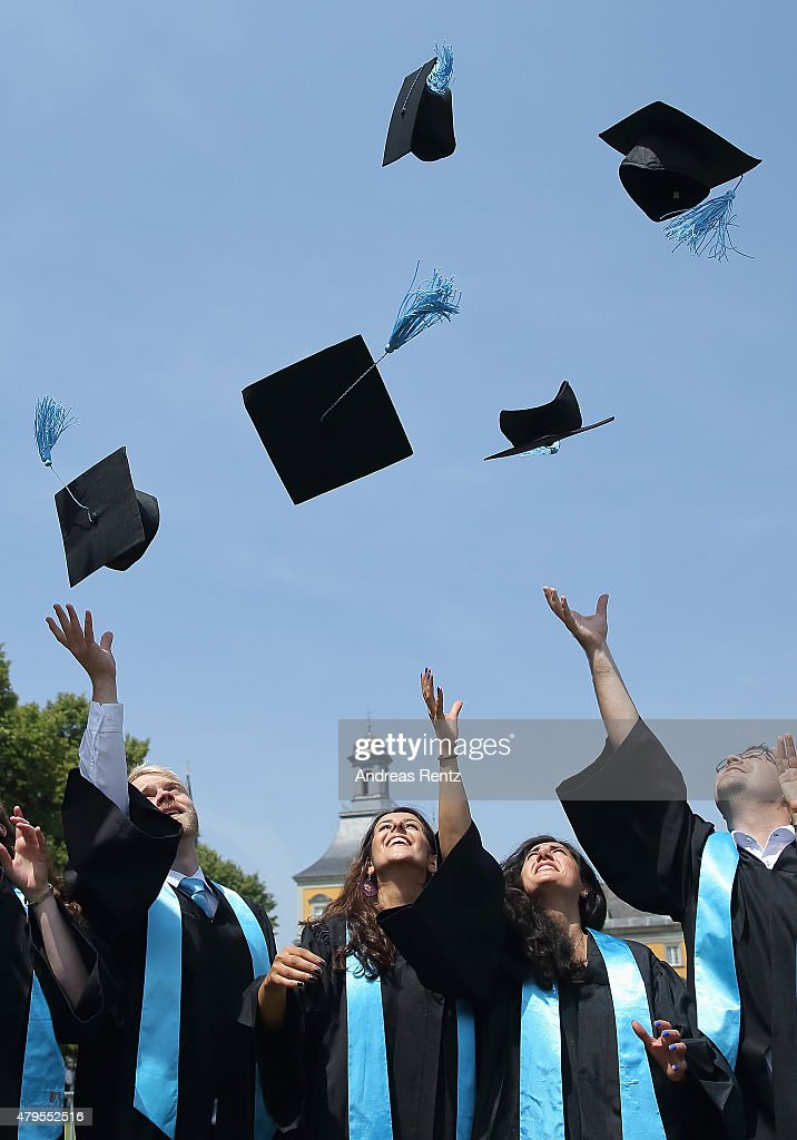 Students throw up their graduate caps during the 11th celebrations of the Rheinische Friedrich-Wilhelms-Universitaet on July 4, 2015 in Bonn, Germany. This year, 780 women and 293 men finished their studies successfully.
