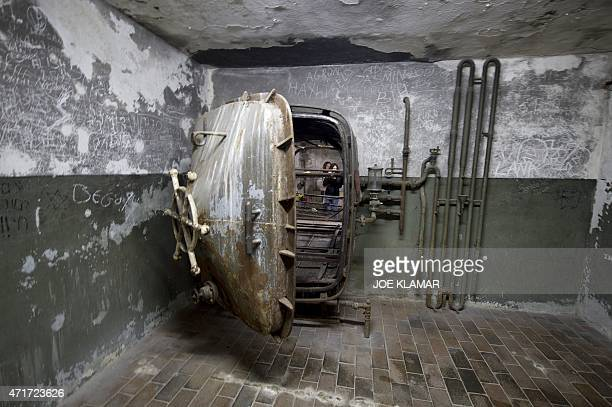Students tour the disinfection/washing room during a visit to former Nazi concentration camp Mauthausen northern Austria on April 28 2015 AFP PHOTO /...
