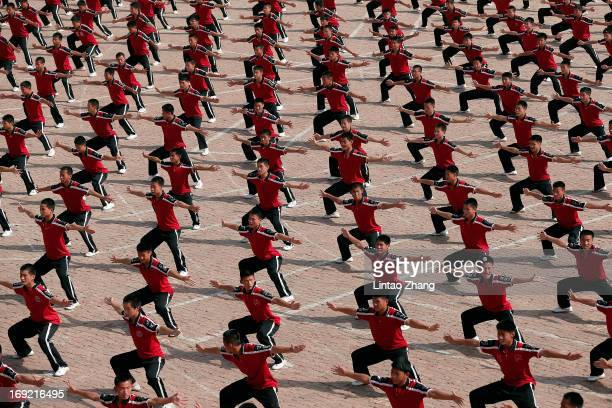Students train at the Tagou Martial Arts School near the Shaolin Temple on Songshan Mountain on May 20 2013 in Dengfeng of Henan Province China