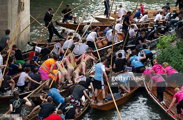 Students try to pass a gorge portion on the Necker river in Thuebingen southern Germany on June 7 2012 50 punts competed this year at the traditional...